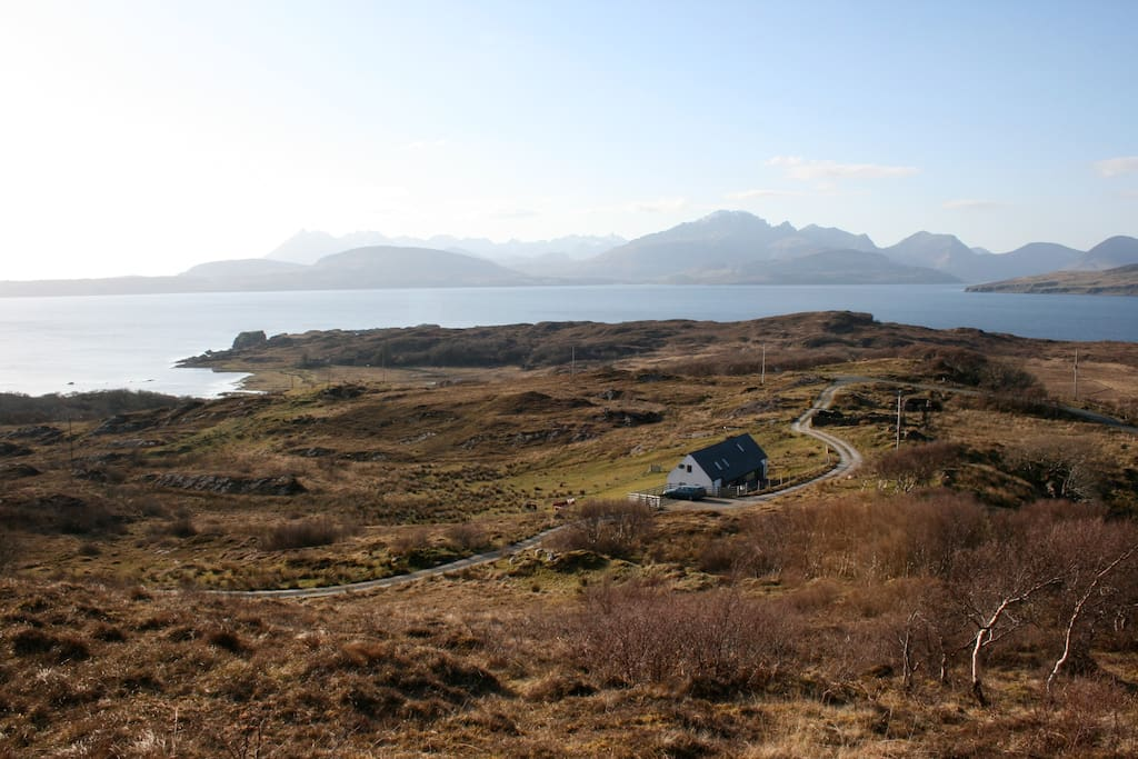 The Longhouse at Tokavaig with the Cuillin mountains in the background