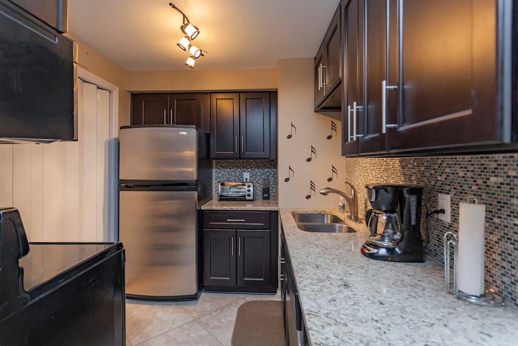 Kitchen with toaster oven and coffee maker.