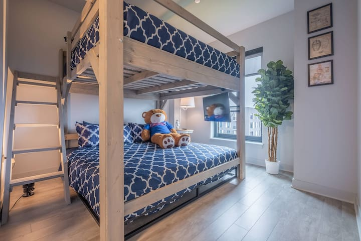 Master bedroom offers the coolest adult bunk bed you've ever seen - two king mattresses support 2,000 pounds, plenty of don't-bang-your-head-clearance and an oversized ladder. Everything about it was built for comfort.