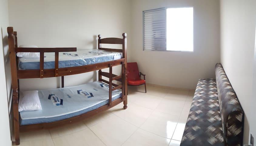 Bedroom with bunk bed, extra mattress and single bed. Bring your own sheets , pillows and blankets. Quarto com beliche, colchão extra e cama de solteiro. Traga roupa de cama, travesseiros e cobertores.