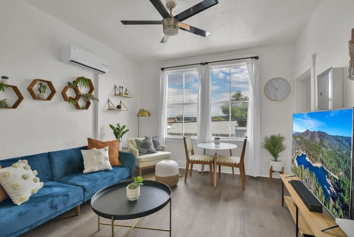 Main living space with a futon that folds down into an extra bed, comfy reading chair and table with chairs for two. Enjoy free tv channels while having the ability to also login to your netflix account!