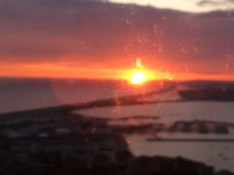 Sunrise, sunsets, bird-watching over Chesil Beach.