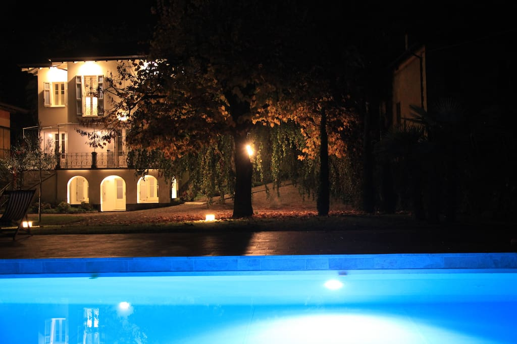 The pool and garden by night