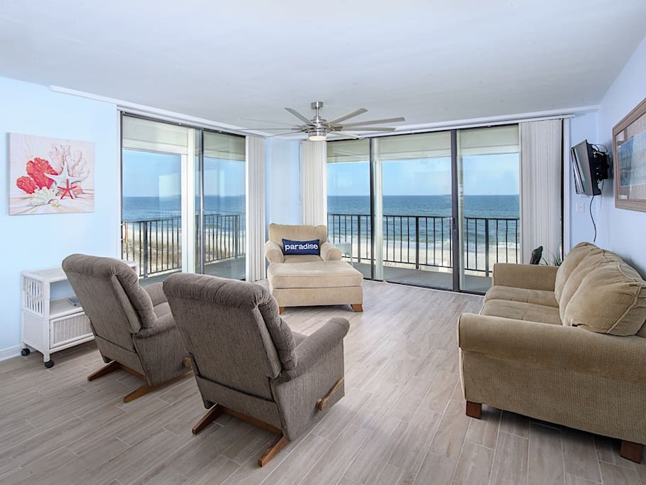 The living area with floor-to-ceiling corner windows affording unparalleled views of the Gulf shoreline