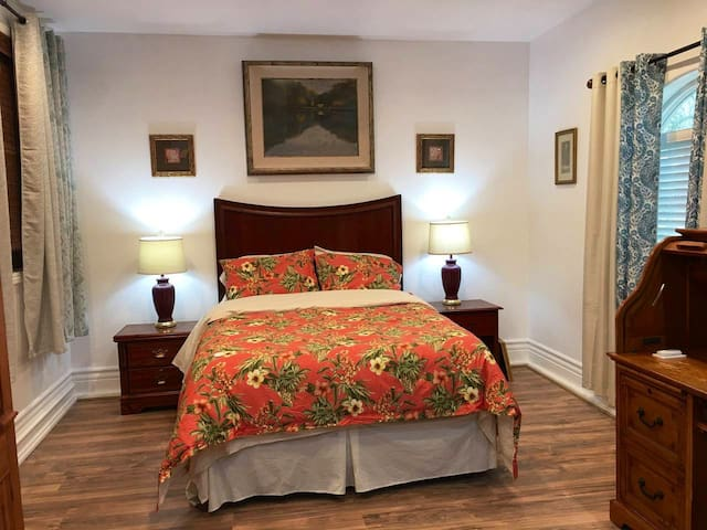 Queen size bed with premium bedding and mattress