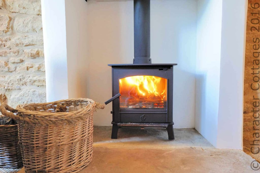 The stylish log burner will keep you warm, even on a cold winter's day!