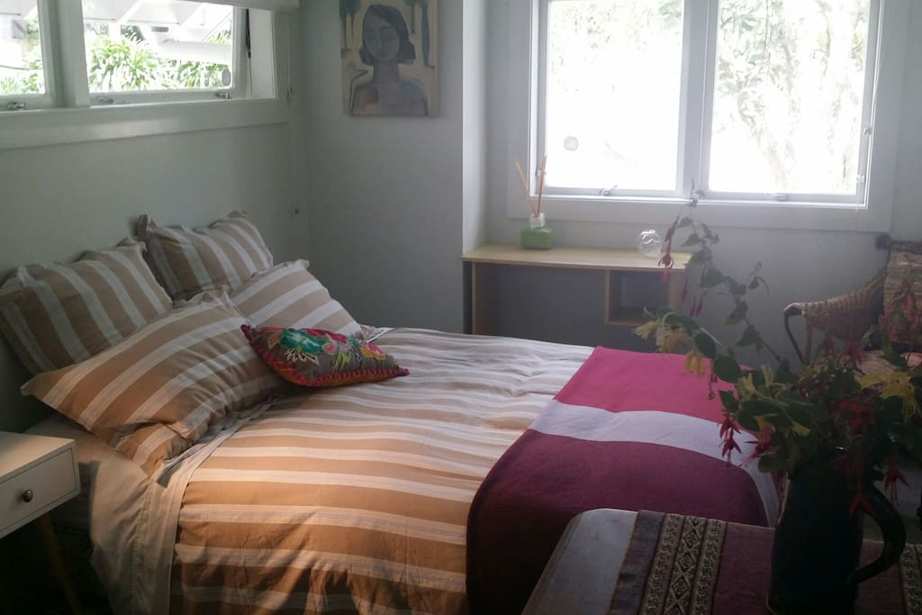 Double bed light filled bedroom with outlook onto quiet street