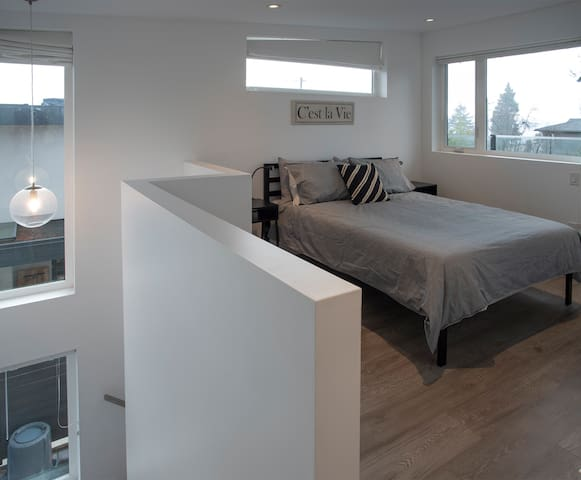 Upstairs loft-style master bedroom with Queen bed.
