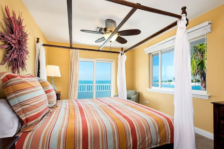 This first-floor bedroom has a queen-size bed.  There is also a terrace where one can enjoy a breathtaking ocean view daily.