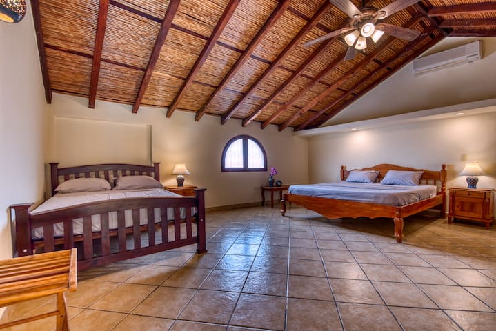 Bigger bedroom on the upper floor with a queen and a king bed.