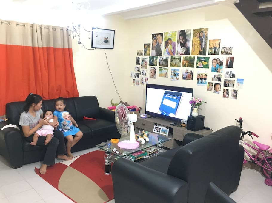 Here's what our living room looks like we have free wifi, I have 2 kids and 2 maids to assist you with your needs