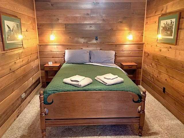 The Master Bedroom in the Guest Cabin (Full bed) feels very woodsy, with all of the knotty pine...