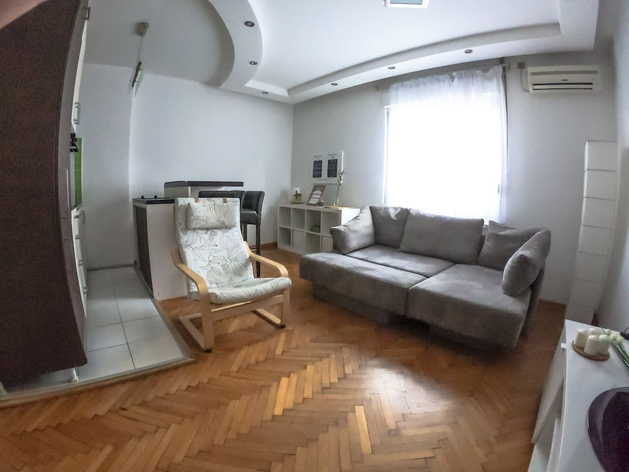 Modern living room with kitchen island  which serves as dining area for 4 persons. Comfortable sofa for lounging. Air Conditioning and central heating will make sure the temperature is perfect even during coldest winter and hottest midsummer days.