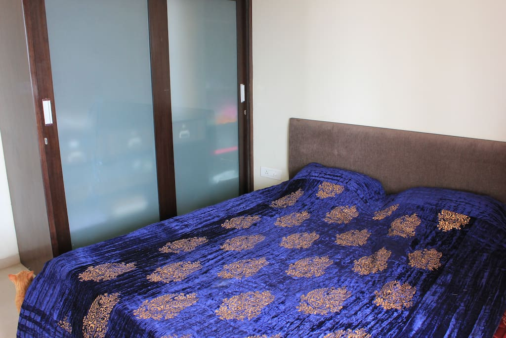 private room with kind size bed, big cabinet and direct access to terrace
