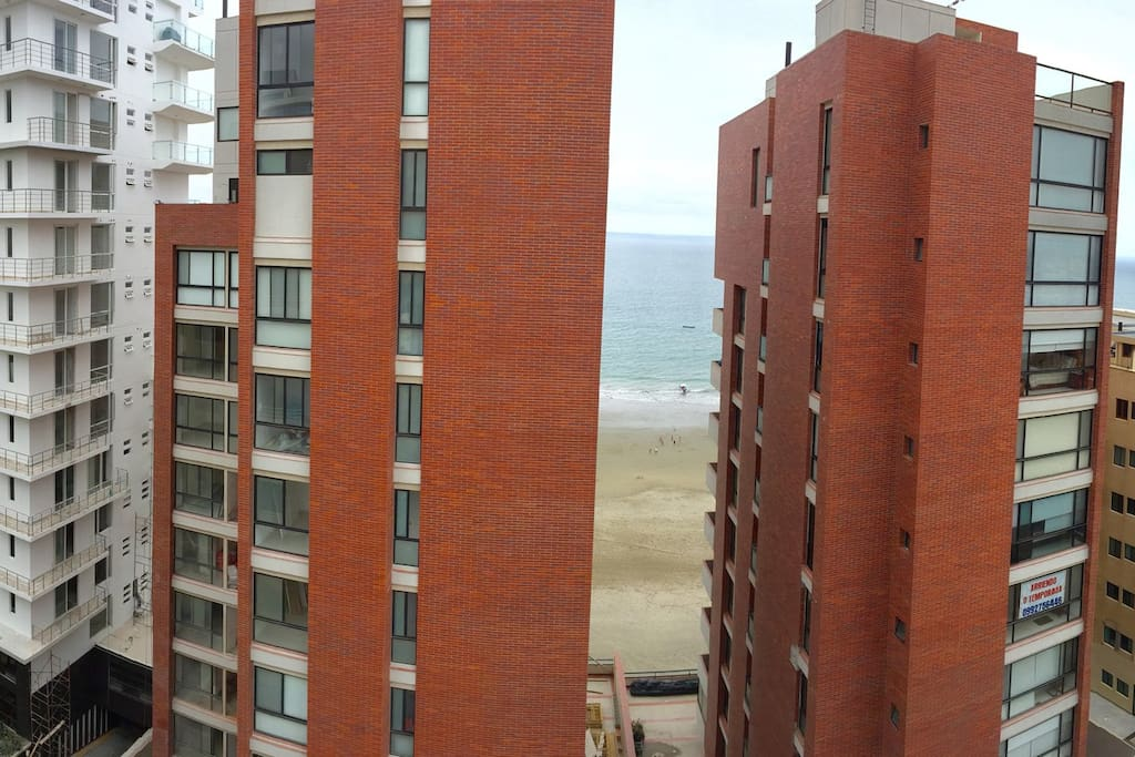 The west-facing balcony features the beaches, Manta's fancy condo district and to the right, the working Port of Manta