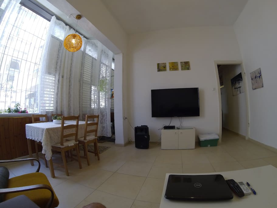 Living room with 55 Inch LED TV and Dining area with huge windows