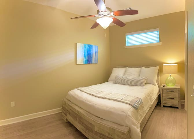 The 2nd bedroom has a queen bed ideal for two guests