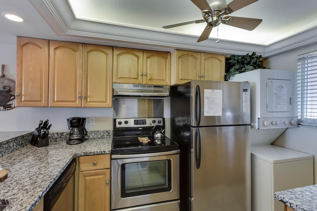Upgraded kitchen with granite countertops, stainless steel appliances and washer and dryer