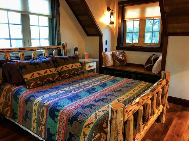 Your cozy queen sized bed with memory foam mattress topper and plenty of pillows