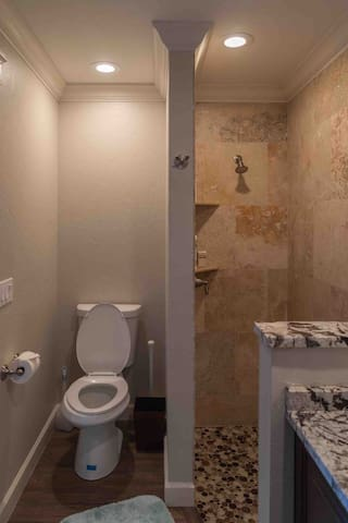Bathroom - Walk-in Shower and Toilet (has pocket door for privacy to main area)