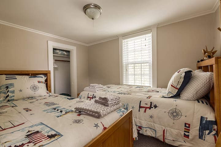 Dual twin beds in the second bedroom.