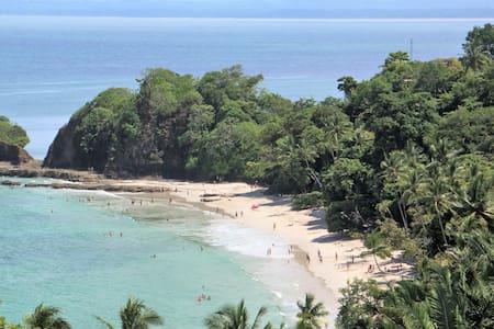 Walk to Playa Blanca Punta Leona from luxury condo