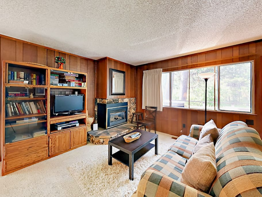 Get comfortable in the wood-accented living room.