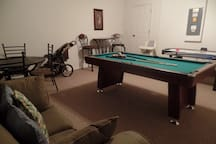 Games room with pool and air hockey.