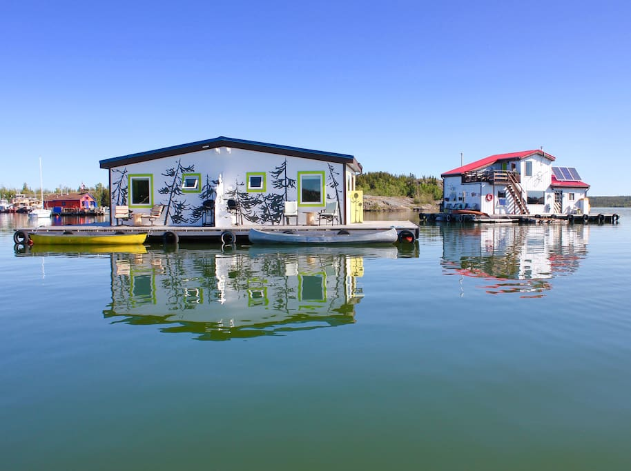 Owner's houseboat in the background, 30 meters away: You will always have assistance 24 hours a day, summer or winter! A canoe is provided with each of the two suites, to get back and forth to shore. Very effective sound proofed common wall exists between them.