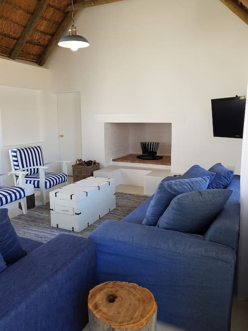 living area with fireplace and full DSTV
