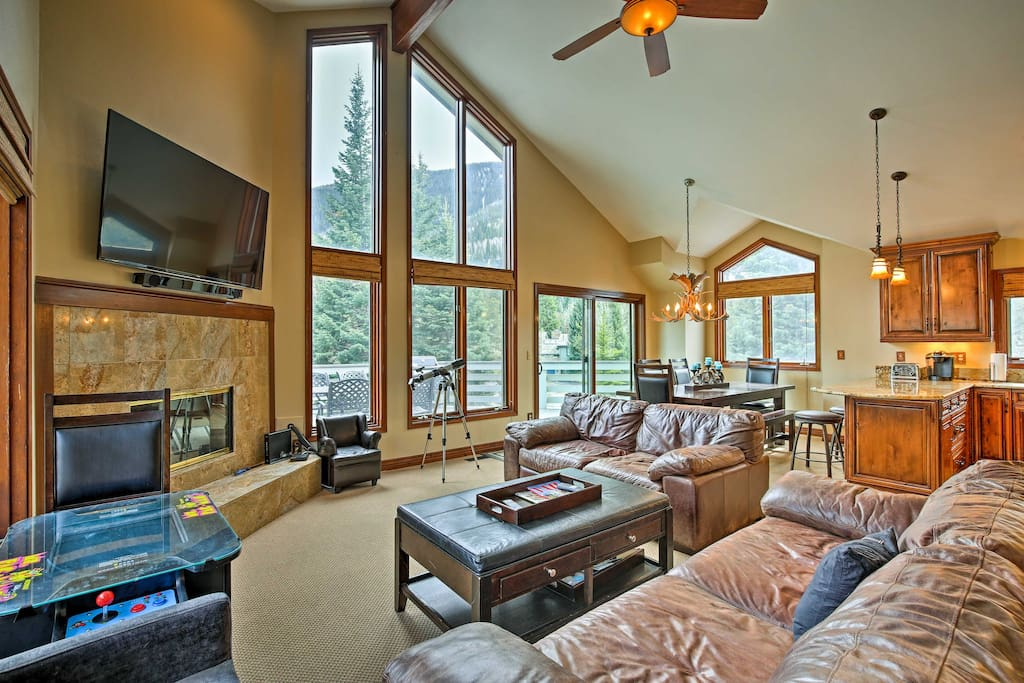 The interior is lined with tall windows to bring the alpine backdrop indoors.