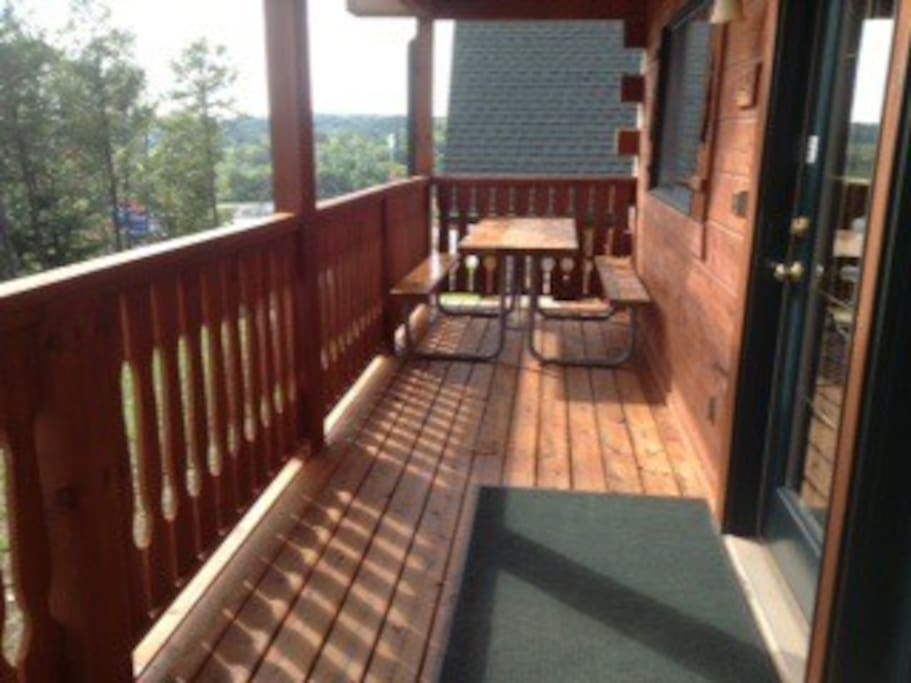 Large porch with picnic table.