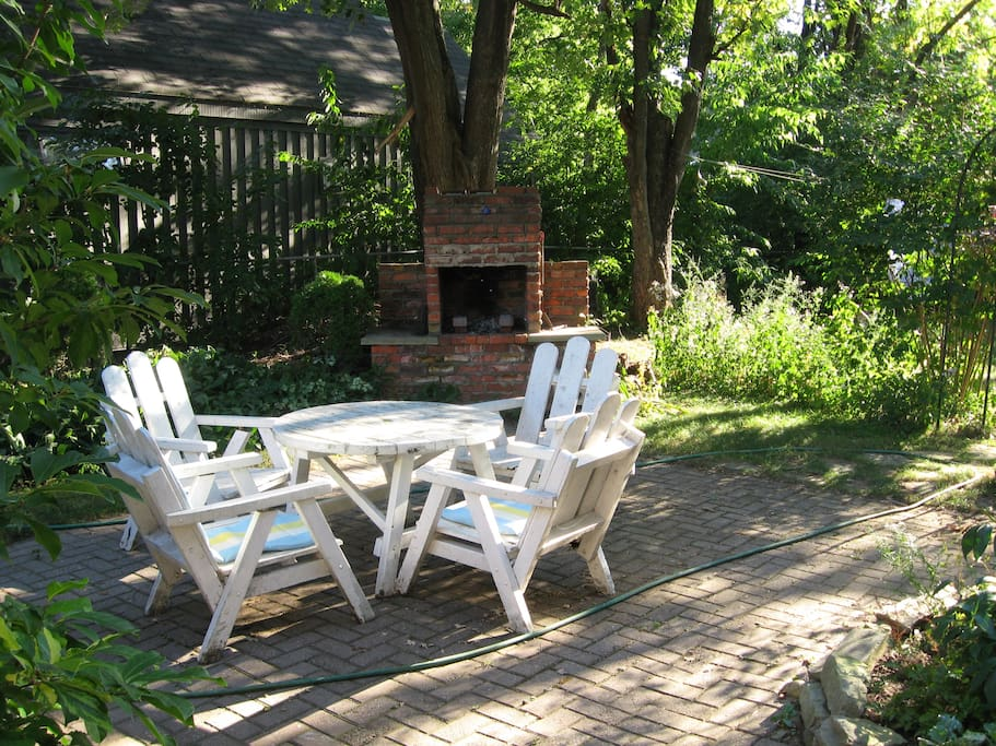 shaded patio with red brick barbecue
