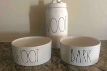 Treats and bowls for your furry family member to enjoy
