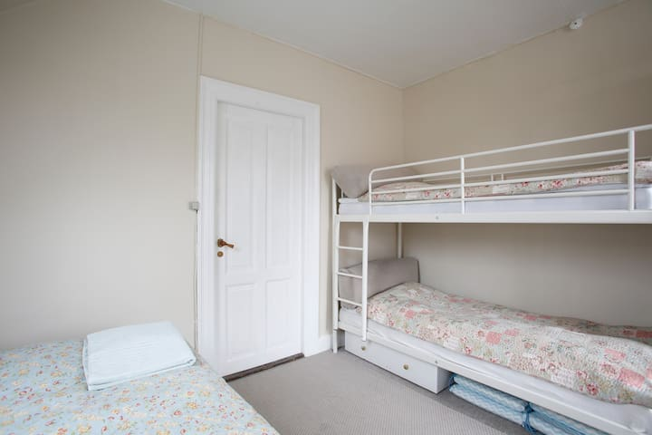 Room 2: The bunk bed that fint two adults in length.