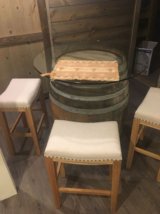 Whiskey/wine barrel dining table.  seats four