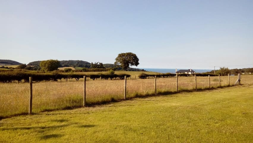 Large private caravan in Welsh hills with sea view