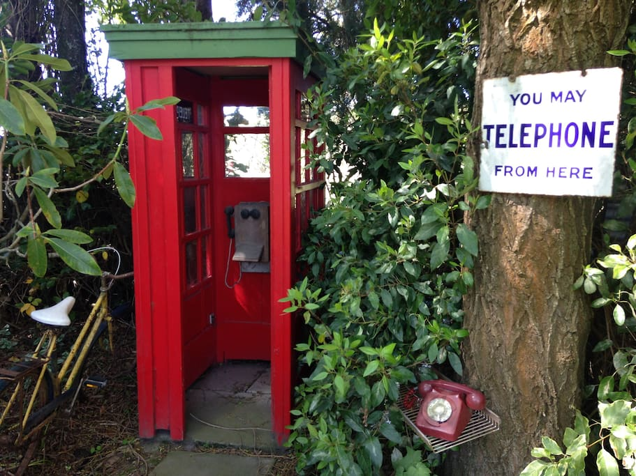 Old New Zealand Memorabilia is scattered around the garden like tis old Phone Box