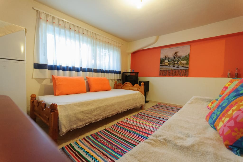 The living room space of the studio, has one single bed and a single sofa-bed