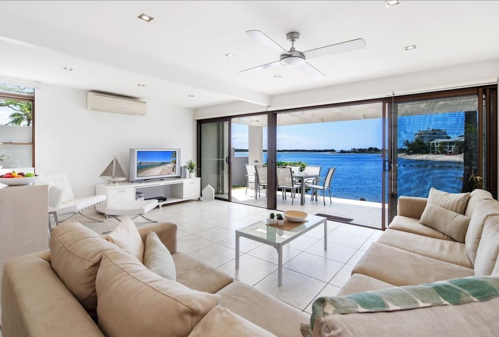 Step from living area straight onto private entertaining deck and beach