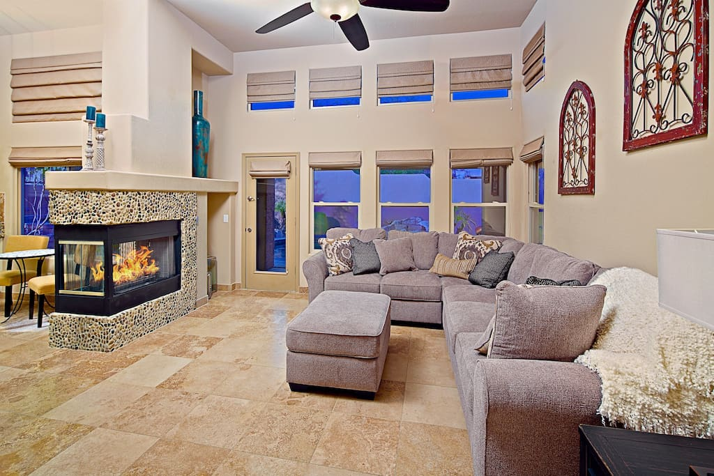 Relax and enjoy natural light and a romantic fireplace.