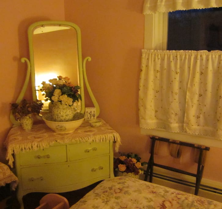 The Rosey Room is  warm & pretty, with a comfy Queen and private bath.
