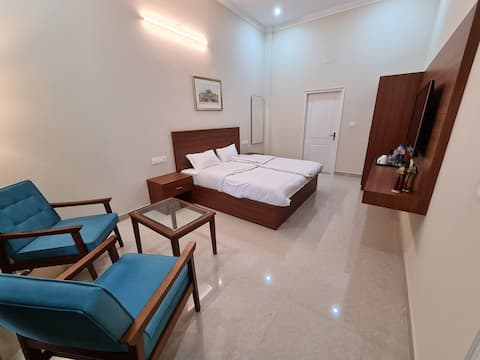 220sq feet Spacious room. with attached bathroom.