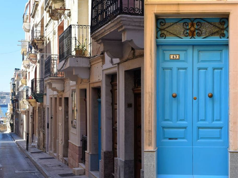 Located in narrow street leading down to Grand Harbour (with front balcony) and traditional brightly painted,  wooden front door with brass handles