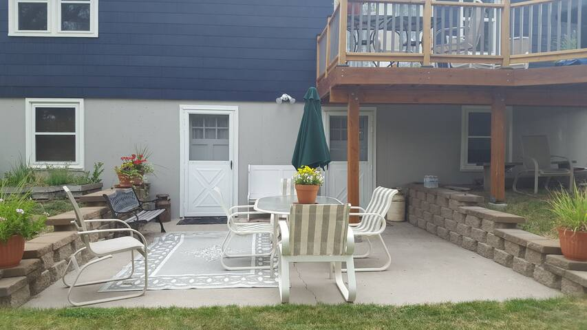 Your own private entry door with access to our back patio.   Bike trails are nearby as well as a beautiful city park within walking distance.   Self check-in available with lockbox for key so that you can check in at any hour of the night.