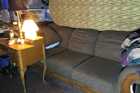 Couch in basement. - Staten island