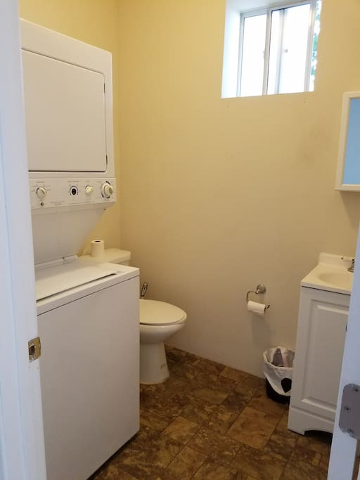 Downstairs bathroom with washer and dryer