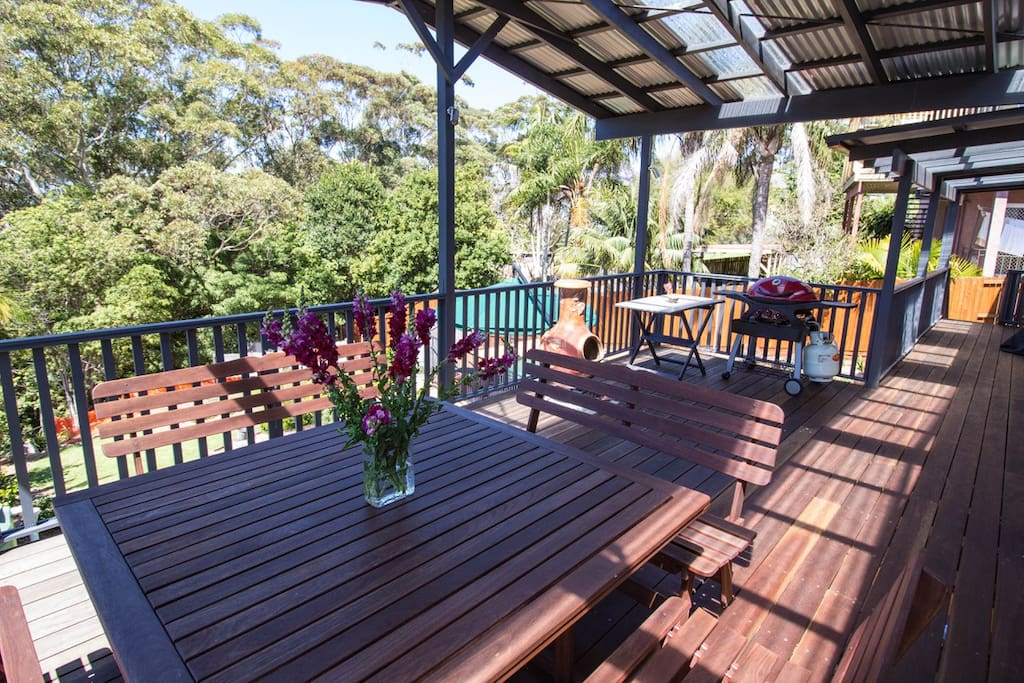 Spacious, covered deck area with BBQ
