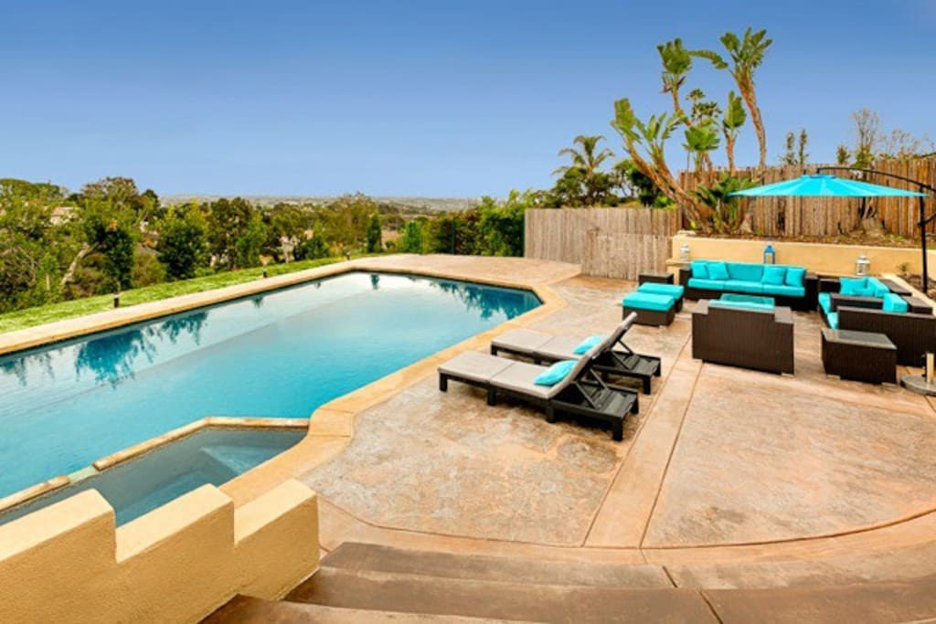 Pool and hot tub with plenty of patio furniture