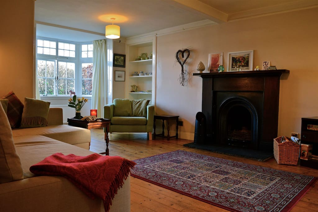 Main room with double sofa bed and open fire. Views over River Tweed to Peebles.